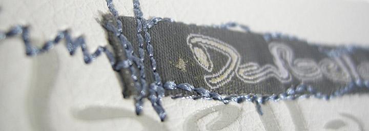 Hybridtygmärke - vävt, broderat och läder