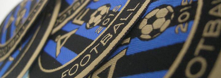 Vävda tygmärken med laserskuren kant för Åkersberga FC